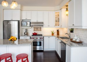 white kitchen with multiple appliances in it.