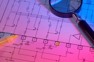 electrical blueprint with magnifying glass
